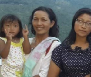 Theint Sandi Soe, right, pictured with her mother and sister.