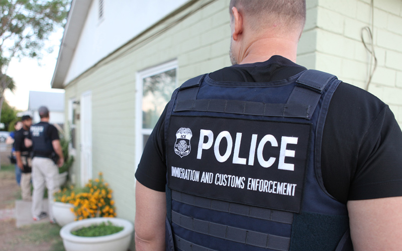 Immigration and Customs Enforcement (ICE) conduct arrest in a residential area.