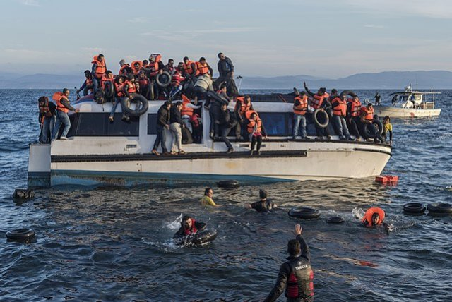 Migrants arrive by boat in Greece