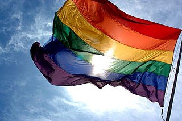 Rainbow flag and blue skies