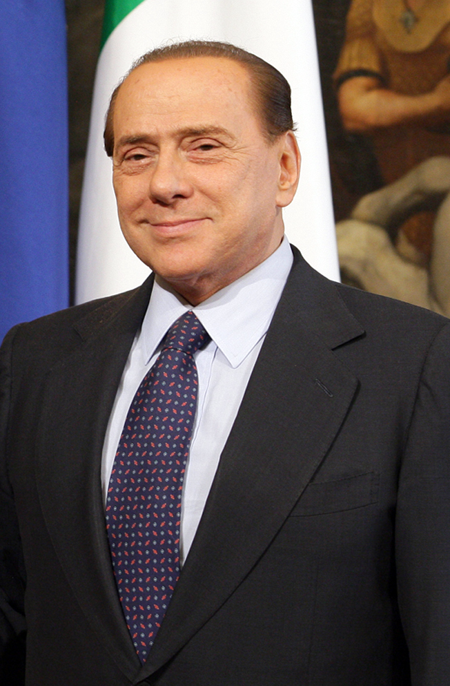 Italy court reduces sentences of former Berlusconi aides