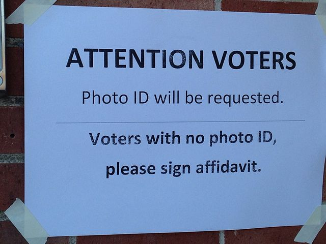 Federal judge rules Texas voter ID law discriminatory