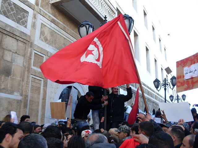 Tunisia grants amnesty to thousands amid protests