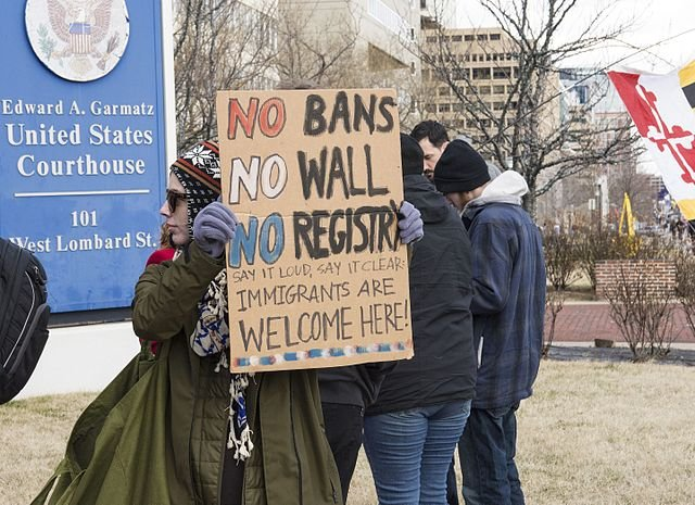 Federal appeals court allows partial implementation of travel ban