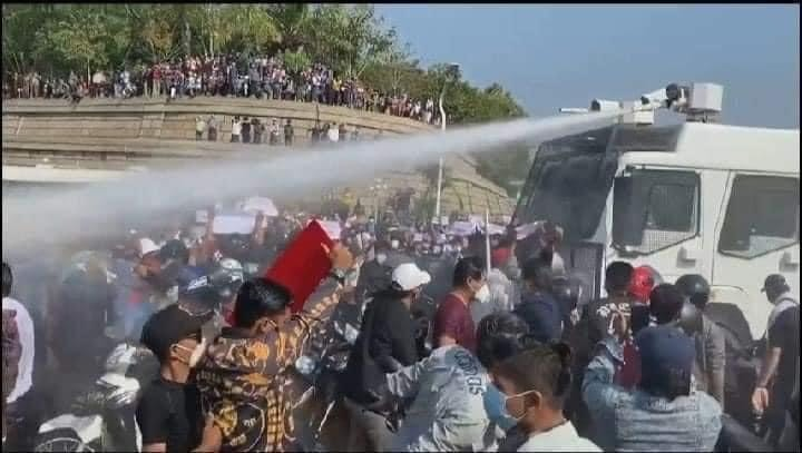 Myanmar coup protesters targeted by water cannons as military threatens legal crackdown, orders curfew